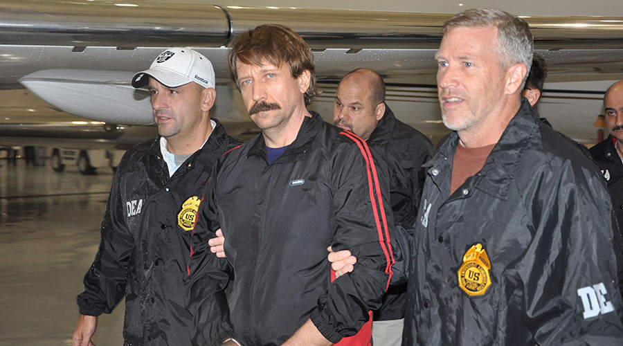 FILE PHOTO: Suspected Russian arms dealer Viktor Bout (C) is escorted by Drug Enforcement Administration (DEA) officers after arriving at Westchester County Airport in White Plains, New York November 16, 2010. © US Department of Justice