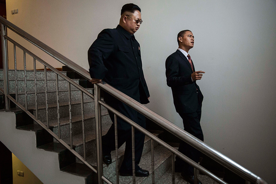 Chinese actor and United States President Barack Obama impersonator Xiao Jiguo and North Korean leader Kim Jung Un impersonator Jia Yongtang wait before a brief appearance together on a film set on October 20, 2015 in Beijing, China © Kevin Frayer