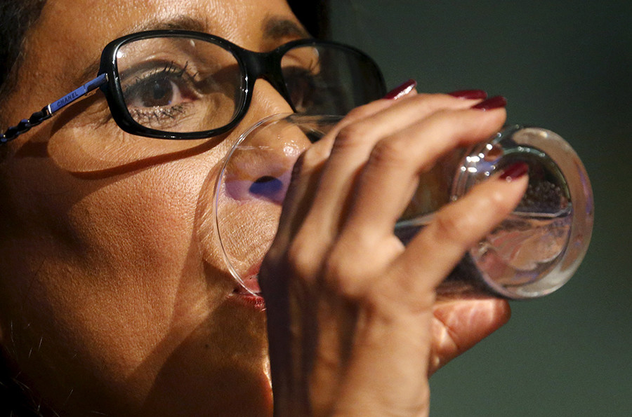International Olympic Committee (IOC) Evaluation Commission head Nawal El Moutawakel drinks a water during a news conference in Rio de Janeiro, Brazil, August 12, 2015 © Sergio Moraes