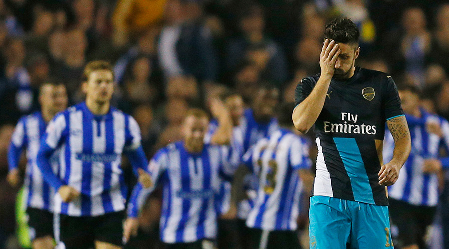 Arsenal's Olivier Giroud looks dejected after Sheffield Wednesday's third goal © Jason Cairnduff