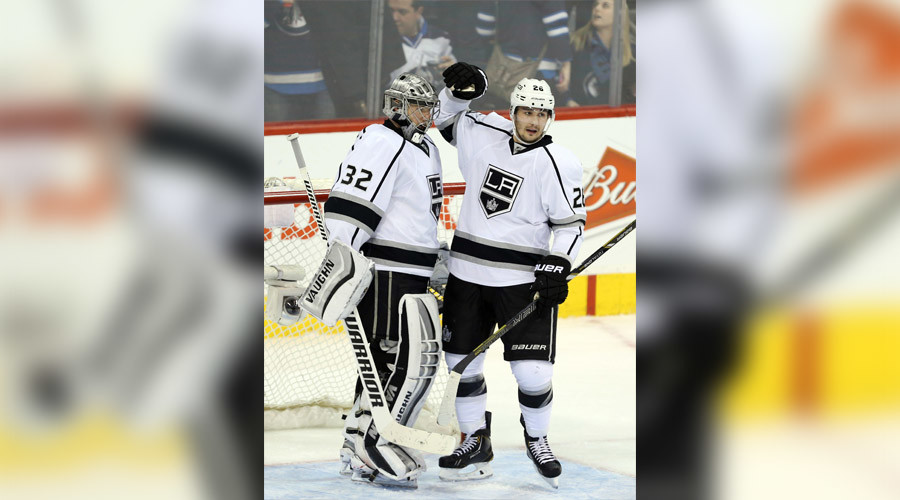 Jonathan Quick (32) and Slava Voynov (26) © USA Today Sports