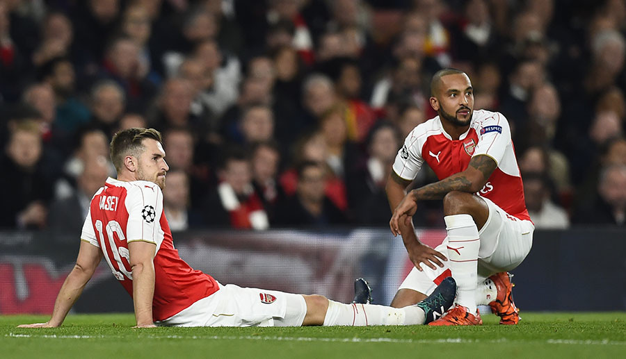 Arsenal's Aaron Ramsey with Theo Walcott after sustaining an injury. © Dylan Martinez