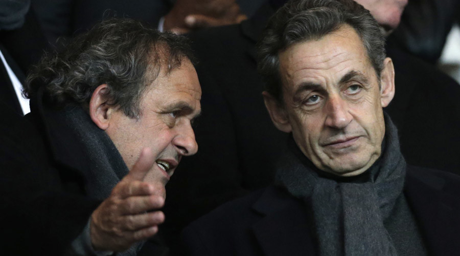UEFA President Michel Platini (L) and former French president Nicolas Sarkozy speak ahead of the Champions League match Paris St Germain vs Chelsea. Paris February 17, 2015. © Christian Hartmann