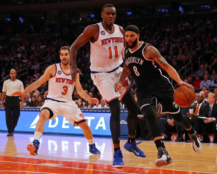 Brooklyn Nets guard Deron Williams (8) dribbles the ball past New York Knicks center Samuel Dalembert (11) © USA Today Sports