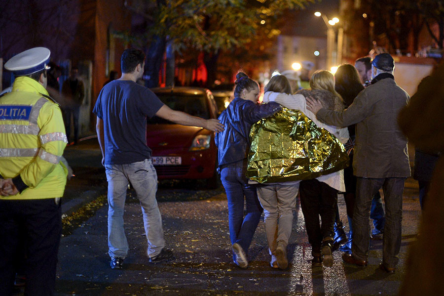 People walk outside a nightclub following an explosion in Bucharest, Romania October 31, 2015. © Inquam Photos