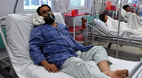 A wounded staff member of Doctors Without Borders (MSF), (L), survivor of the US airstrikes on the MSF Hospital in Kunduz, receives treatment at the Italian aid organization, Emergency's hospital in Kabul on October 6, 2015. © Wakil Kohsar