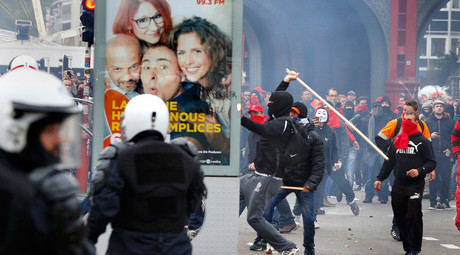 A demonstrator smashes an advertising panel during clashes at a march against government reforms and cost-cutting measures in Brussels , October 7, 2015. © Yves Herman
