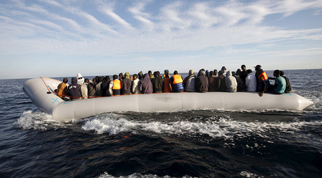 Migrants, who tried to flee to Europe, travel in a dinghy after they were stopped by Libyan coast guards and made to head to Tripoli © Ismail Zitouny
