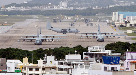 Hercules aircraft are parked on the tarmac at Marine Corps Air Station Futenma in Ginowan on Okinawa © Issei Kato
