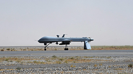 A U.S. Predator unmanned drone armed with a missile stands on the tarmac of Kandahar military airport. © Massoud Hossaini
