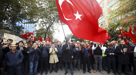 Supporters of Gulen movement wave Turkish flags during a protest outside the Kanalturk and Bugun TV building in Istanbul, Turkey, October 28, 2015. © Osman Orsal