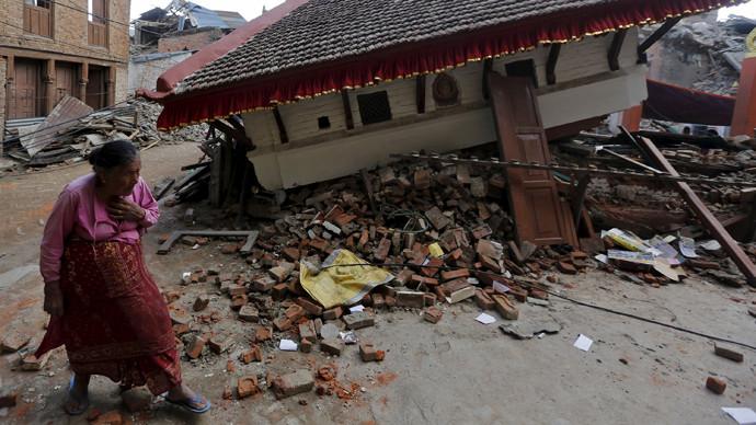 An earthquake victim walks past a collapsed temple in Sankhu, on the outskirts of Kathmandu © Adnan Abidi