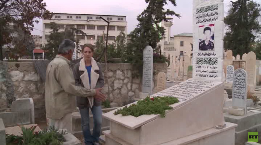 Abdo works in the cemetery amid never-ending mortar fire
