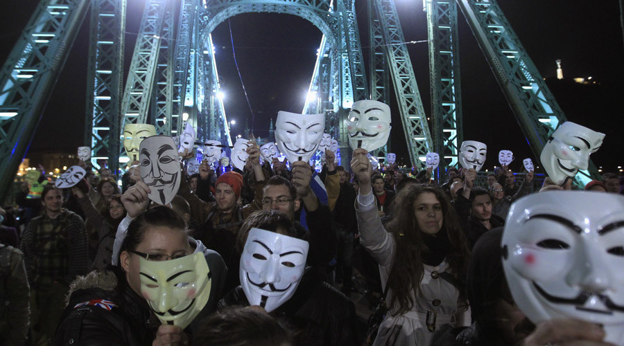 "Protesters hold up their Guy Fawkes masks on the Liberty Bridge during a demonstration by supporters of the Anonymous movement as part of the global ""Million Mask March"" protests, in Budapest, November 5, 2014. © Bernadett Szabo"