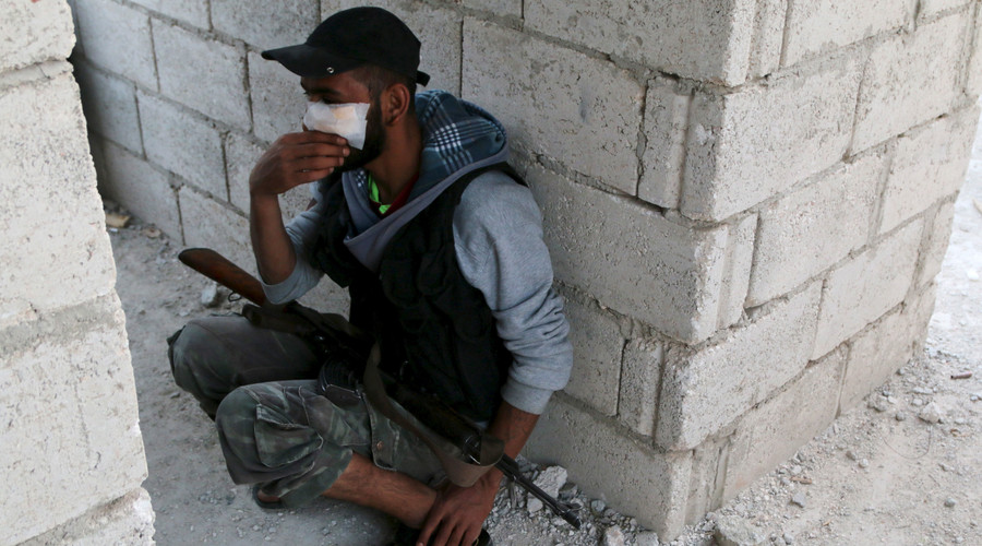 A rebel fighter sits with his weapon at a building after what activists said were clashes with Islamic State fighters in Soran Azaz, Aleppo countryside June 1, 2015. © Mahmoud Hebbo