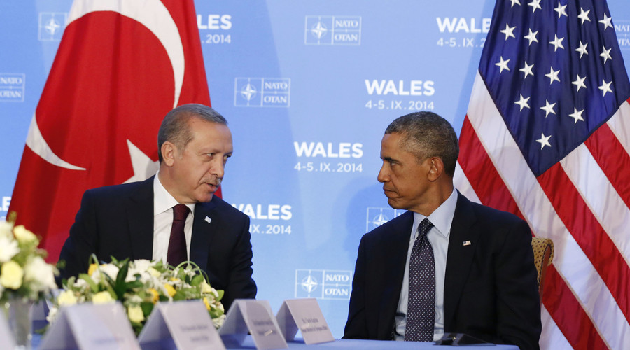 U.S. President Barack Obama listens as he hosts a bilateral meeting with Turkey's President Tayyip Erdogan during the NATO Summit at the Celtic Manor Resort in Newport, Wales September 5, 2014. © Larry Downing