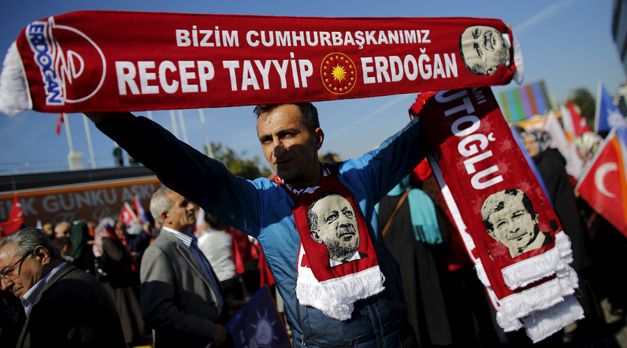 A man holds scarves bearing the names and images of Turkish Prime Minister Ahmet Davutoglu (R) and President Tayyip Erdogan as supporters of the AK Party gather to wait for the arrival of Davutoglu in Istanbul, Turkey November 3, 2015. © Murad Sezer