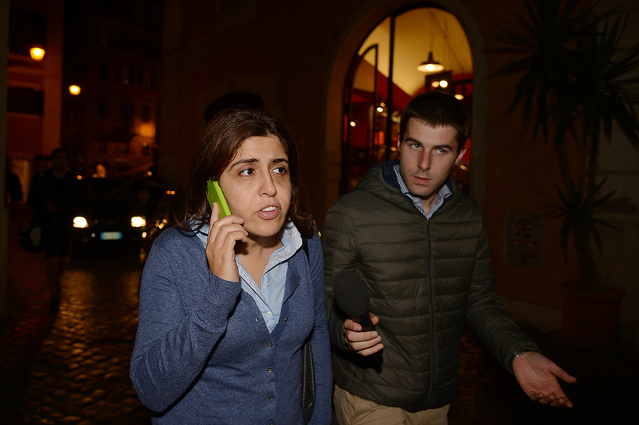 Francesca Chaouqui (L), who was a member of a special commission set up by Pope Francis to advise him on economic reform within the Vatican, speaks on the phone as she walks in the street on November 3, 2015 in Rome © Vincenzo Pinto