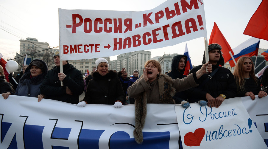 The National Unity Day demonstration in Moscow. Poster reads: Russia and Crimea - Together Forever. © Maksim Blinov