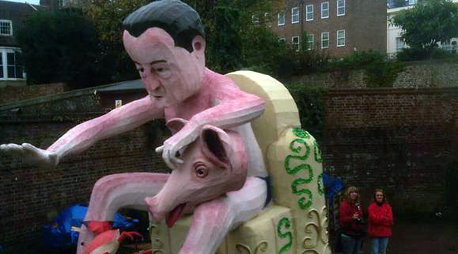 Hog roasted! Lewes bonfire burn effigy of Cameron with a pig's head (VIDEO)