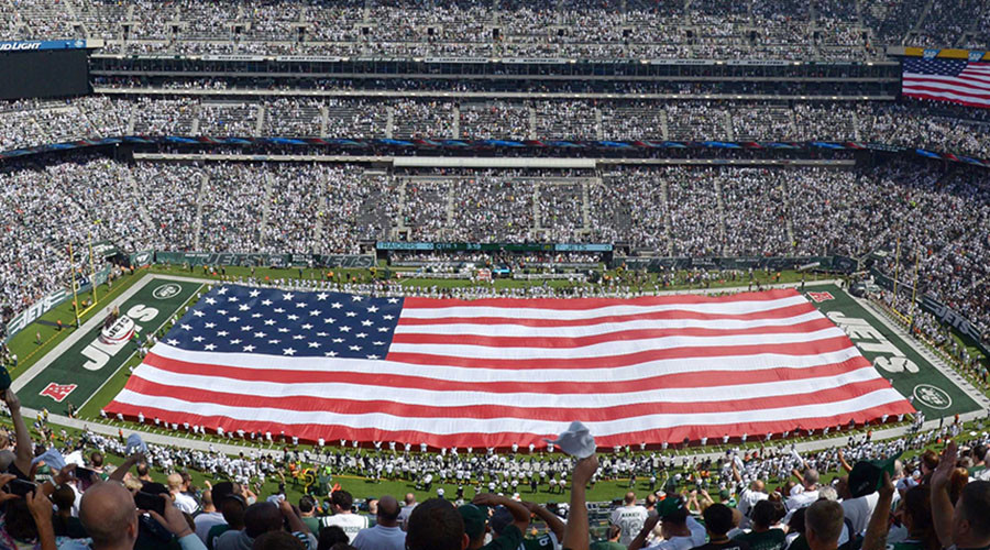 East Rutherford, NJ, USA; General view of the playing of the national anthem with a United States flag on the field before the NFL game between the Oakland Raiders and New York Jets at MetLife Stadium. © Kirby Lee-USA TODAY Sports