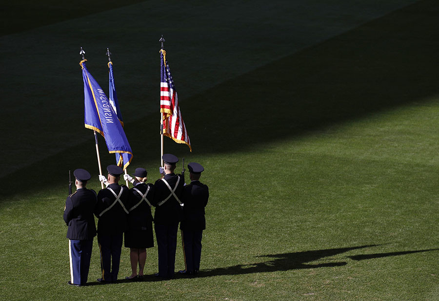 A color guard stands on the field before the start of Game 1 of the MLB National League Championship Series baseball playoffs between the St. Louis Cardinals and the Milwaukee Brewers in Milwaukee, Wisconsin, October 9, 2011. © Jim Young