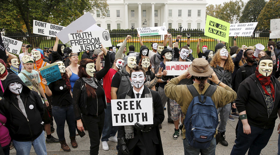 Members of the Anonymous Army, with their signature Guy Fawkes masks, gather in front of the White House during their protest in Washington, November 5, 2015. © Gary Cameron