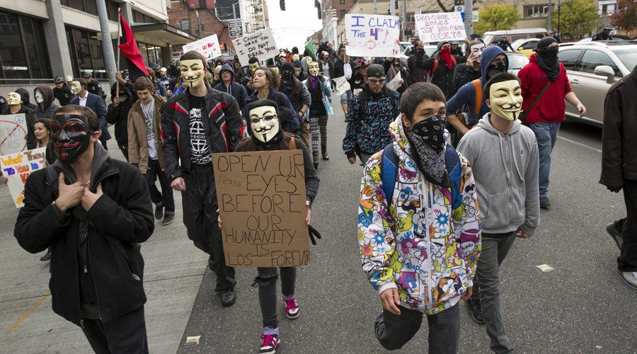 "Anonymous activists wearing Guy Fawkes masks participate in the ""Million Mask March"" in Seattle, Washington November 5, 2015. © Jason Redmond"