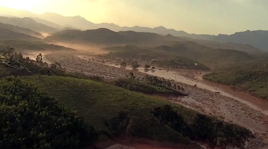 Buried under sea of mud: Aerial footage shows Brazilian town devastated in dam break (VIDEO)