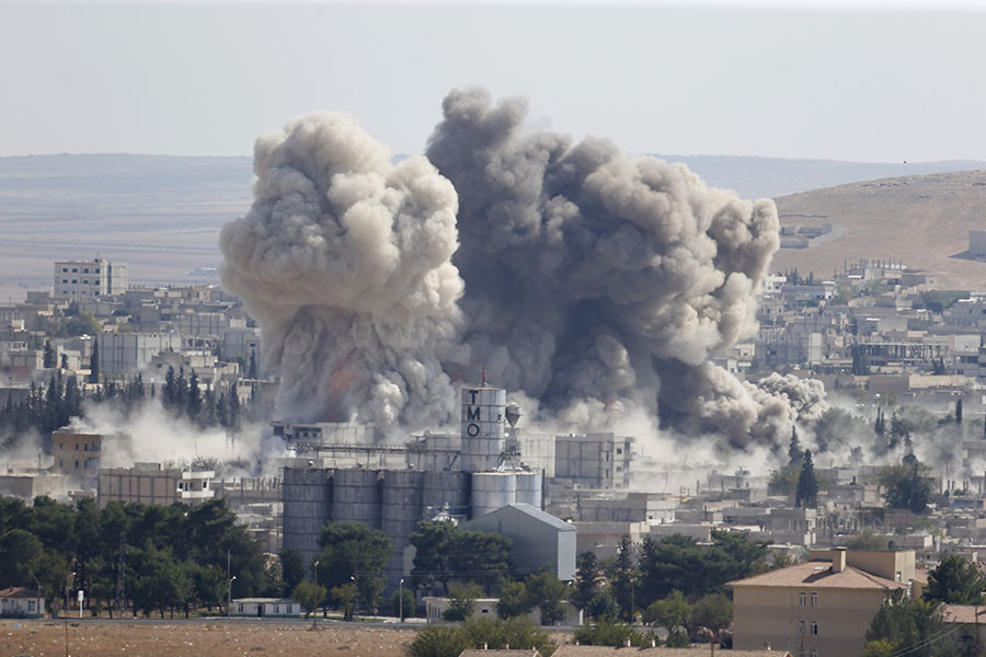 Smoke rises after an U.S.-led air strike in the Syrian town of Kobani Ocotber 8, 2014. ©Umit Bektas