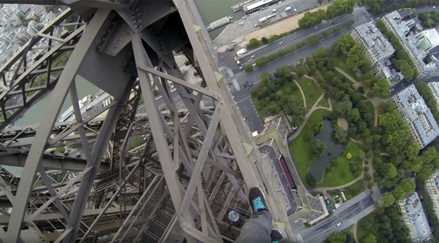 Dizzying footage shows pair climbing Eiffel Tower without harness (VIDEO)