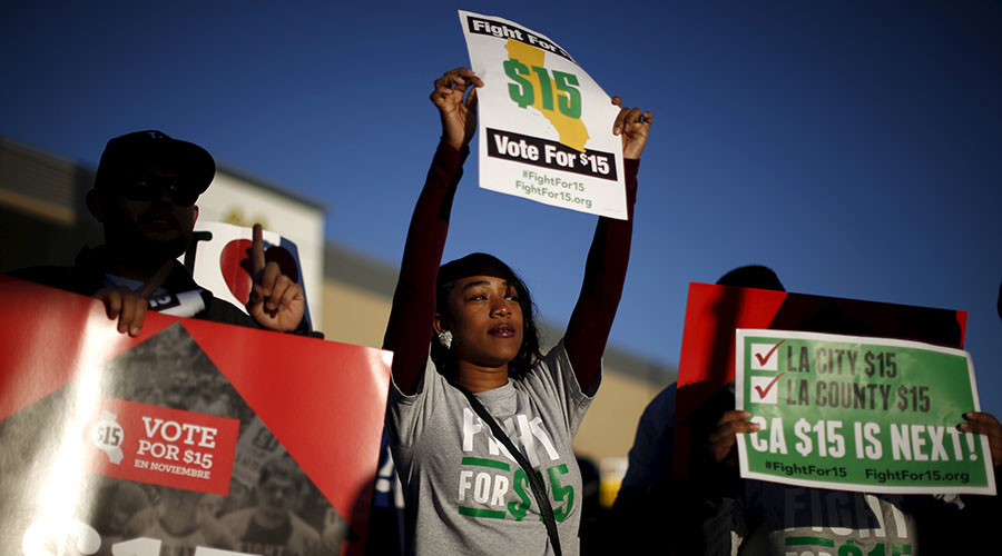 Fast-food workers and their supporters join a nationwide protest for higher wages and union rights outside McDonald's in Los Angeles, California, United States, November 10, 2015. © Lucy Nicholson