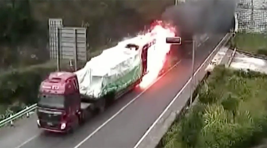 Courageous truck driver barrels through tunnel as vehicle erupts in flames (VIDEO)