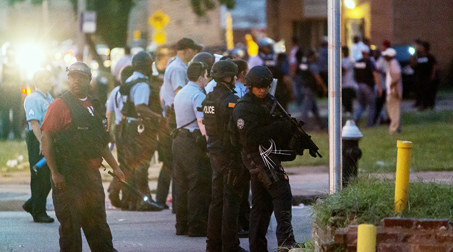 Police line up to block the street as protesters gathered after a shooting incident in St. Louis, Missouri August 19, 2015. © Stringer