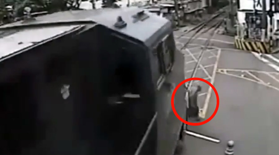 Couldn't care less: Old man in Brazil crosses rail tracks split second before train passes (VIDEO)