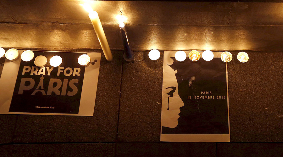 Signs are displayed with candles during a vigil honoring the victims of Paris attacks, in Hong Kong, China November 14, 2015. © Bobby Yip