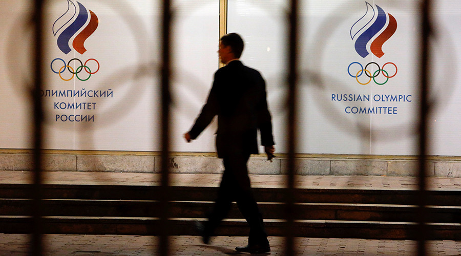 A man walks in front of the Russian Olympic Committee headquarters building © Sergei Karpukhin