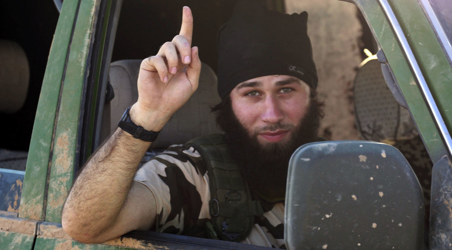 An Islamic State fighter gestures from a vehicle in the countryside of the Syrian Kurdish town of Kobani, after the Islamic State fighters took control of the area October 7, 2014. © Stringer