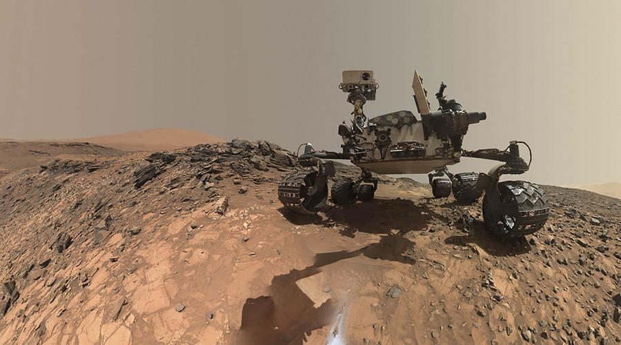 NASA's Curiosity Mars rover is seen at the site from which it reached down to drill into a rock target called 'Buckskin' on lower Mount Sharp in this low-angle self-portrait taken August 5, 2015 and released August 19, 2015. © NASA