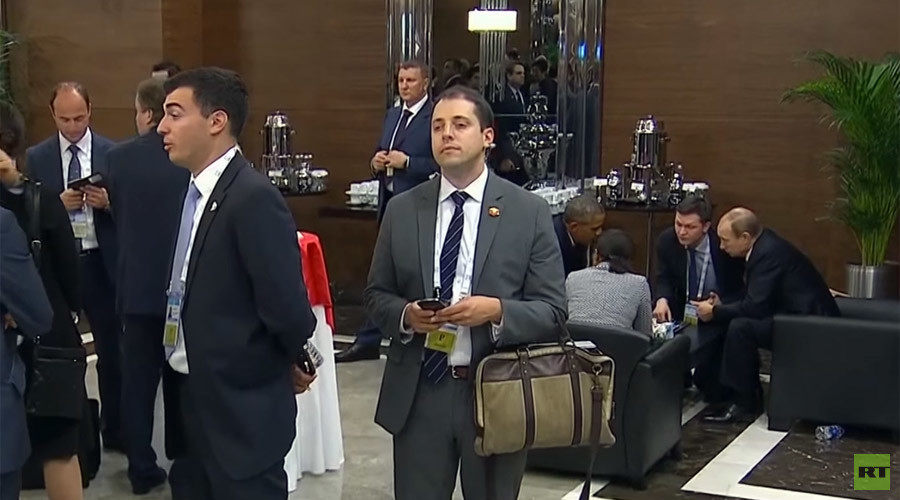 Security breach? Mystery man caught listening in on Putin-Obama talks at G20 (VIDEO)
