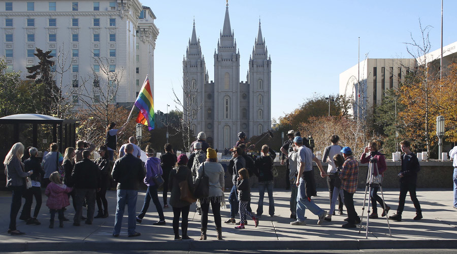 Members of The Church of Jesus Christ of Latter-day Saints and their supporters walk near the Salt Lake Temple after mailing their membership resignation to the church in Salt Lake City, Utah November 14, 2015. © Jim Urquhart