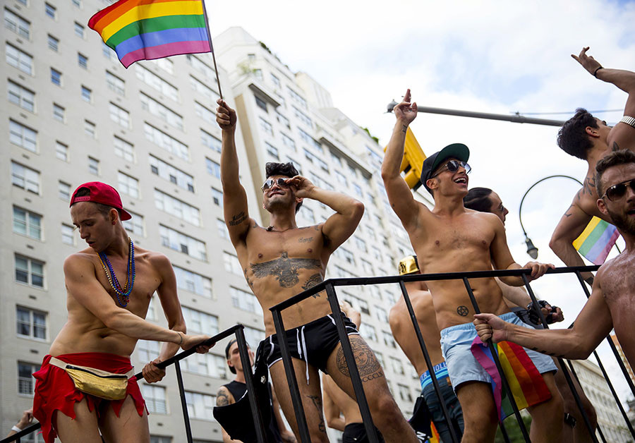 People dance during the annual NYC Gay Pride parade in New York City June 28, 2015. ©Eric Thayer