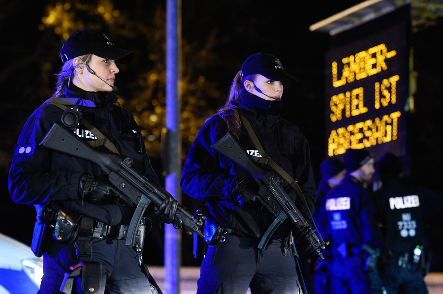 Heavy armed Police stand outside the stadium in front of a board announcing that the match is called off by police due to security reasons © Fabian Bimmer