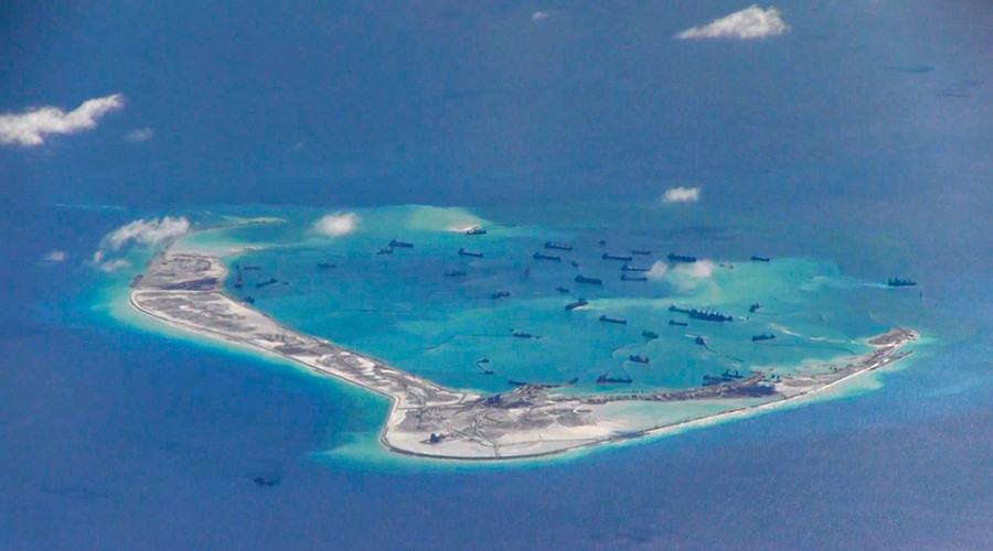 Chinese dredging vessels are purportedly seen in the waters around Mischief Reef in the disputed Spratly Islands in the South China Sea in this still image from video taken by a P-8A Poseidon surveillance aircraft © US Navy