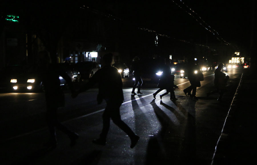 People crossing the road, Simferopol. Early on Sunday November 22, two electricity transmission lines from Ukraine were cut, causing a blackout on the entire peninsula. ©Artem Kreminsky