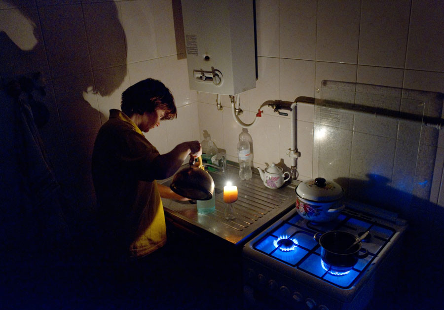 A woman in her kitchen, Simferopol. Early on Sunday November 22, two electricity transmission lines from Ukraine were cut, causing a blackout on the entire peninsula. ©Sergey Malgavko