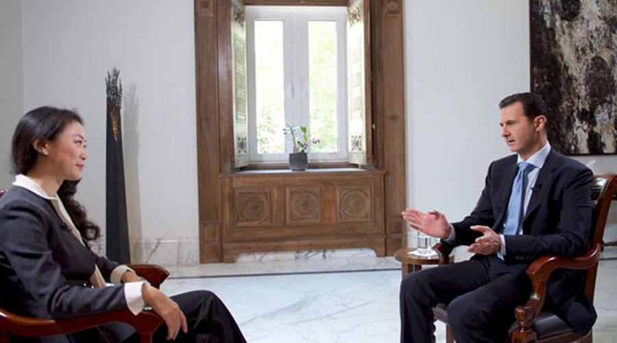 Syria's President Bashar al-Assad speaks during an interview with a journalist from the Chinese Phoenix Television Channel in Damascus, in this handout picture provided by SANA on November 22, 2015 © SANA