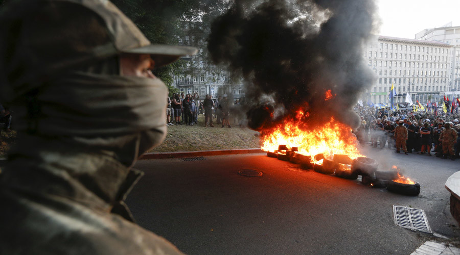 Tyres are set on fire during a rally held by members of the far-right radical group Right Sector, representatives of the Ukrainian volunteer corps and their supporters in central Kiev, Ukraine, July 3, 2015. © Valentyn Ogirenko
