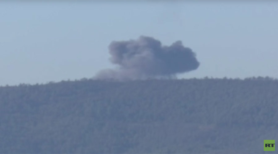 Still of video purporting to show crash site of Su-24 jet near Turkey-Syria border