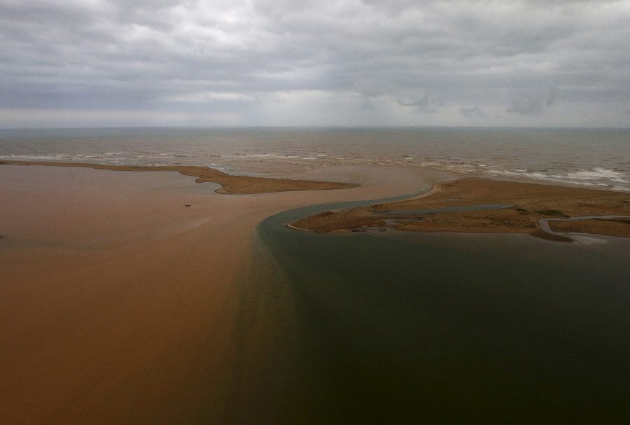 An aerial view of the mouth of Rio Doce (Doce River), which was flooded with mud after a dam owned by Vale SA and BHP Billiton Ltd burst, is seen as the river joins the sea on the coast of Espirito Santo, in Regencia Village, Brazil, November 21, 2015. © Ricardo Moraes